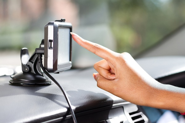 finger pointing at car GPS navigation system